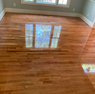 Refinished wood floor in dining room