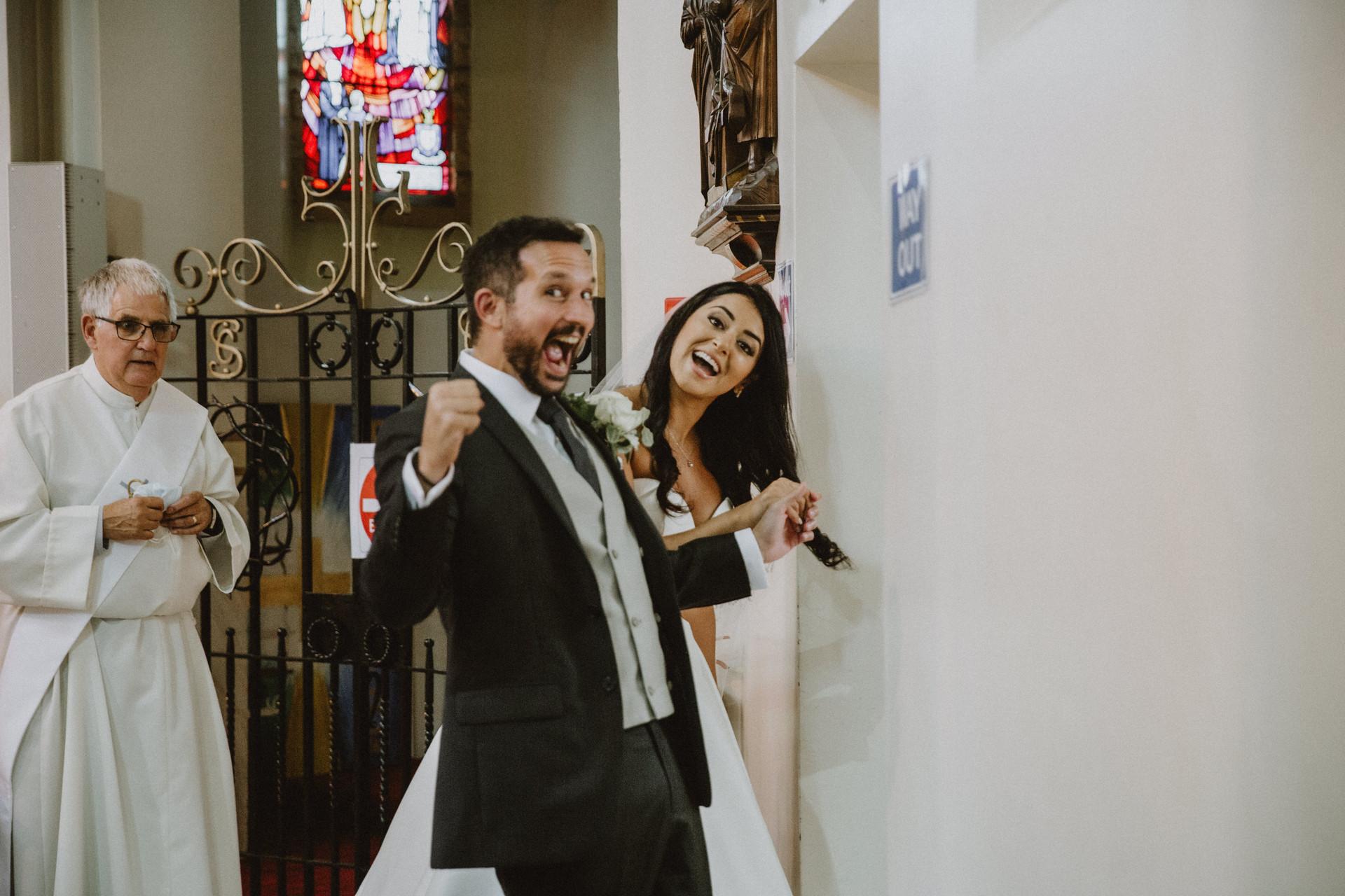 wedding couple priest