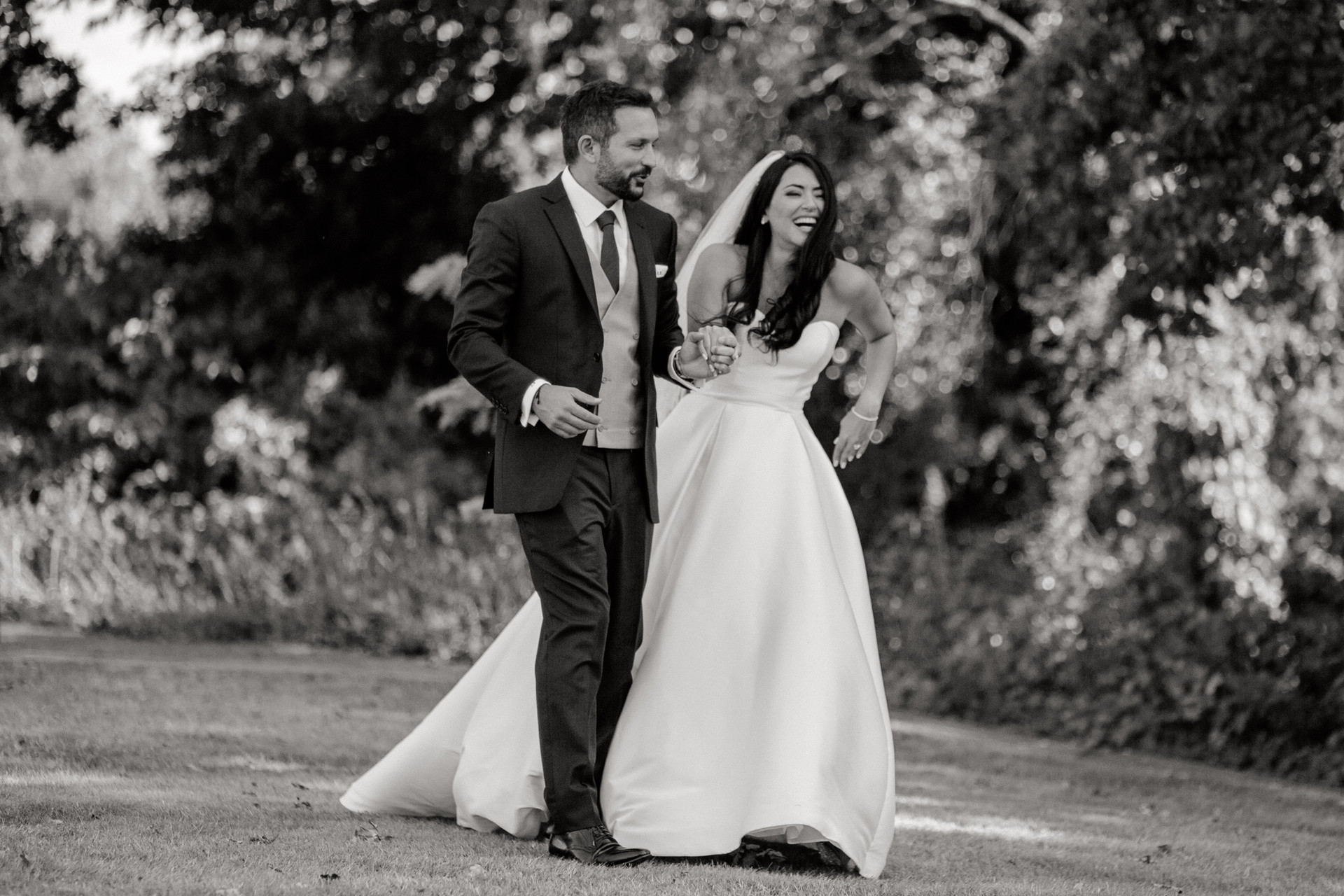 black and white wedding couple walking