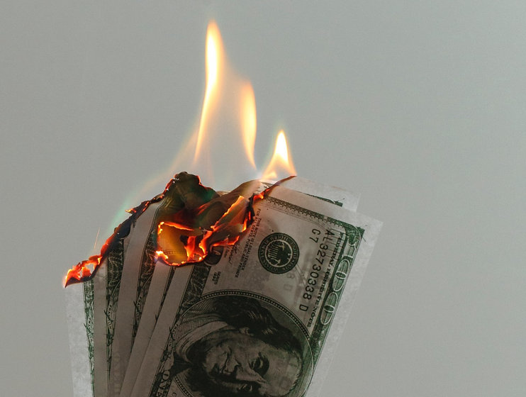 time lapse photography of several burning US dollar banknotes_edited_edited.jpg