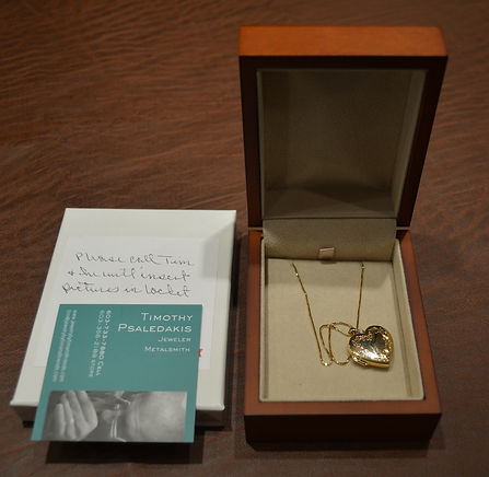 Picture holding14k gold pendant w 18k gold chain by Tim and Friends  valued over $800.JPG