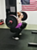 Grace performing a back squat