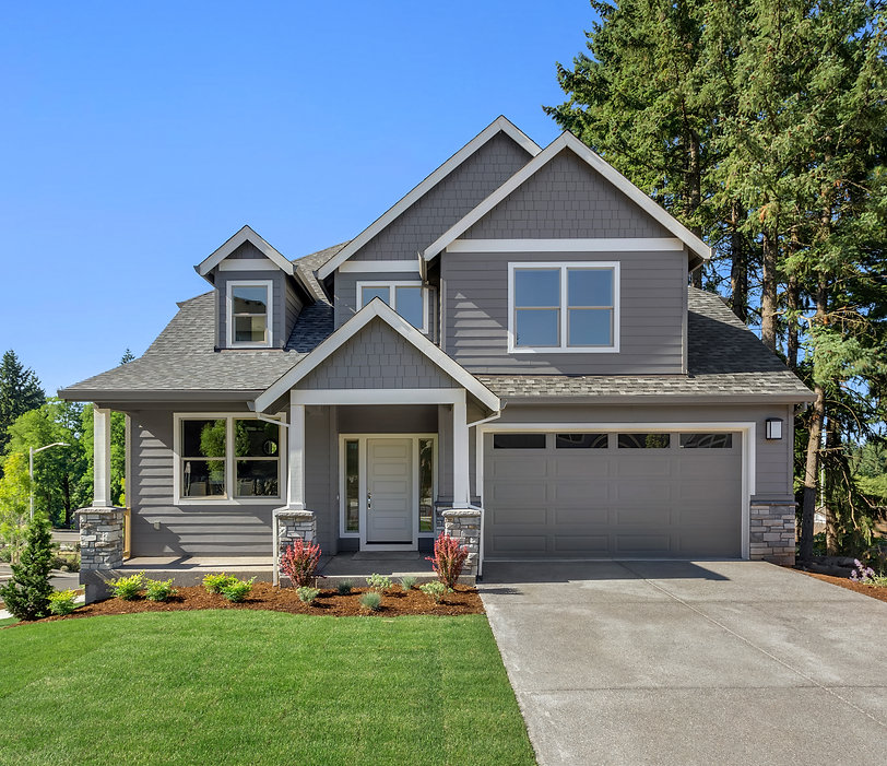 Beautiful new home exterior with two car