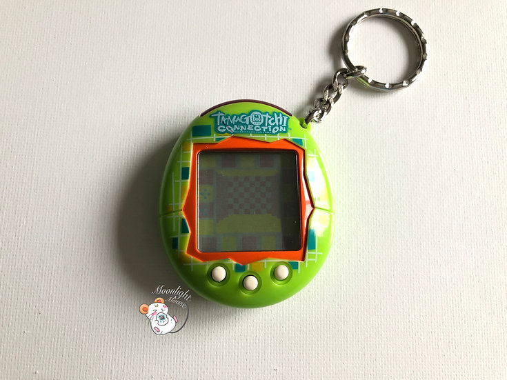 Tamagotchi Connection v1 English Green Blocks Shell 2004