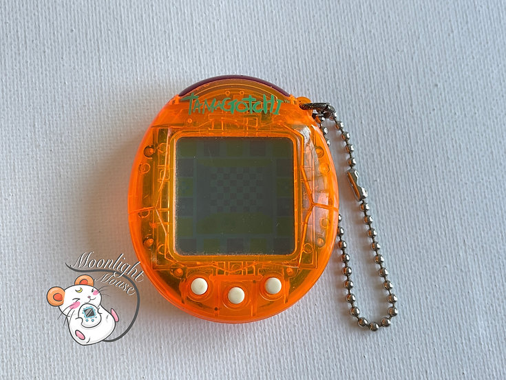Tamagotchi Connection v2 English Transparent Orange Europe Shell 2005