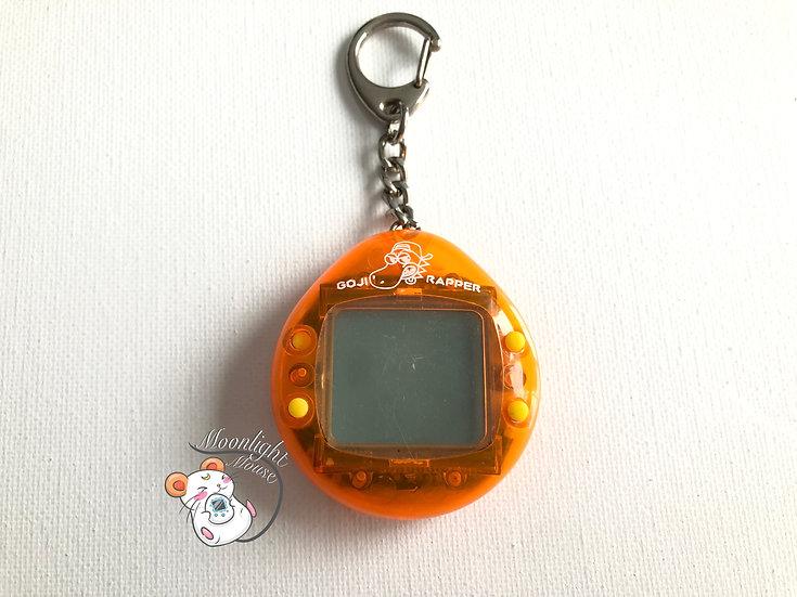 Goji Rapper Orange Dinkie Dino Tamagotchi Virtual Giga Pet 1997