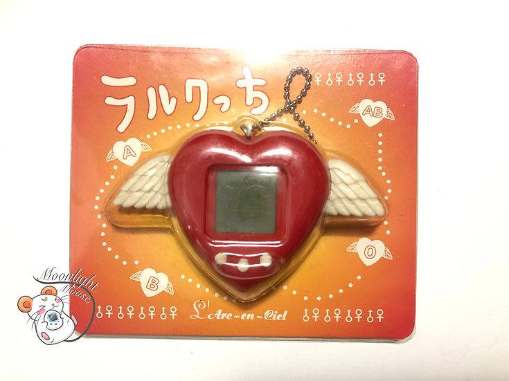 L'Arc-en-Ciel Pocket Love Angel Red Virtual Giga Pet Tamagotchi 1997