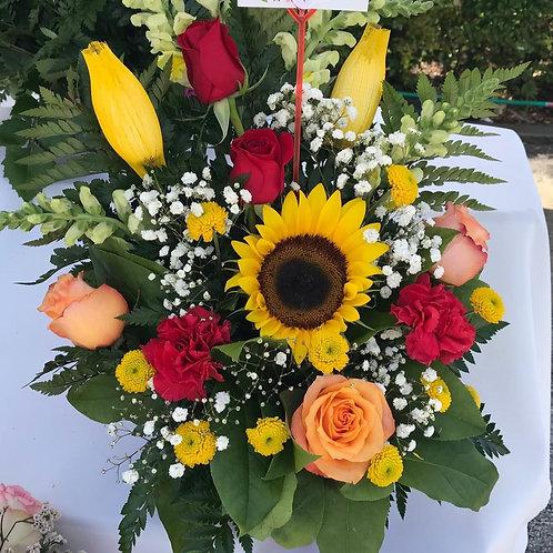 Arrangement sunflower, yellow daisy, roses