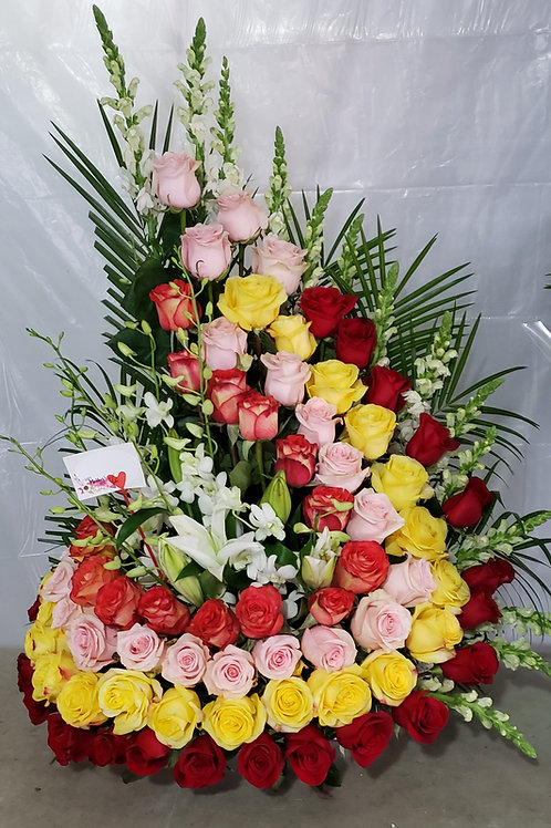 Multicolor rose arrangement 8 dozen with orchid, tropical fillers