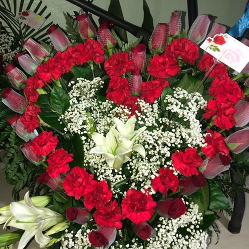 Heart shaped arrangement carnations with lilys