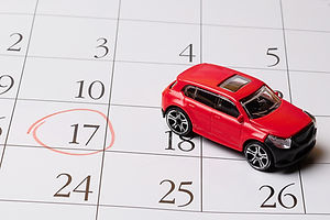 red toy car is located on the calendar,