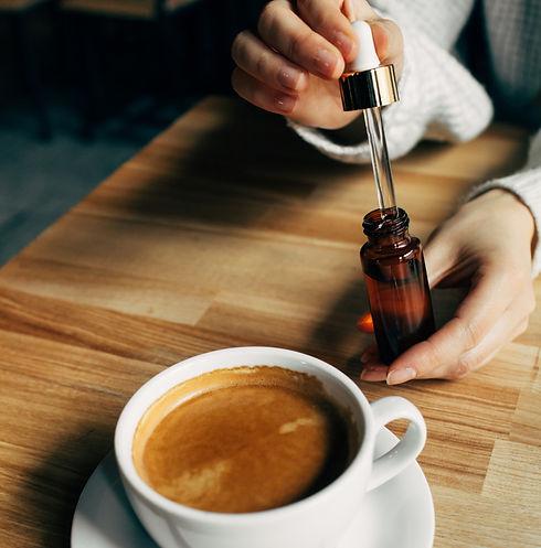 Adding%20CBD%20oil%20in%20a%20coffee%20c