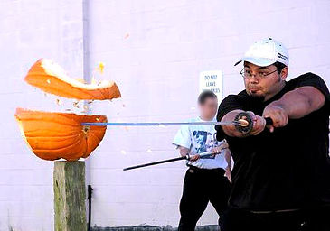 Cutting pumpkin with sword