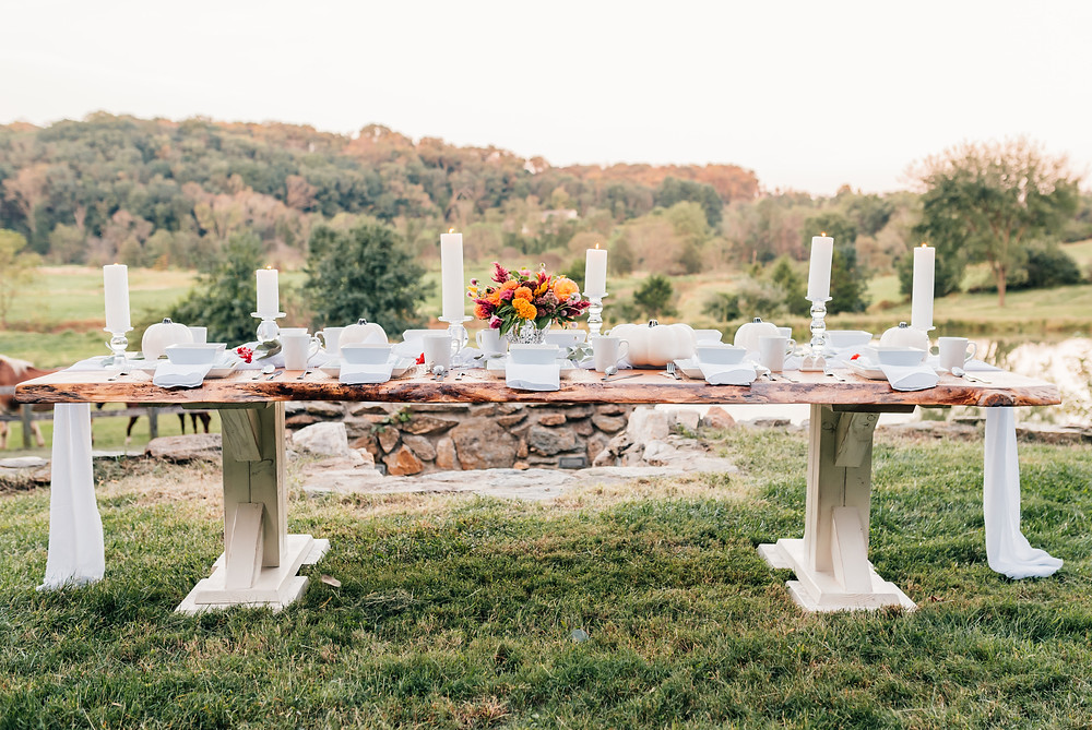 thanksgiving tablescape beautiful landscape candles white table fall flowers fall table fall decor