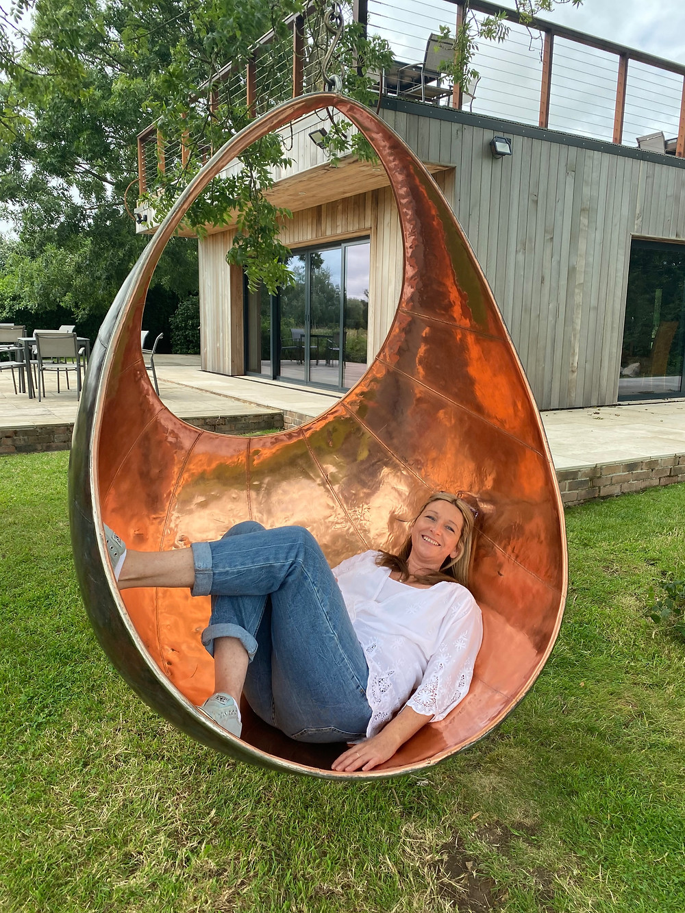Copper swing chair - Sculpture by the lakes