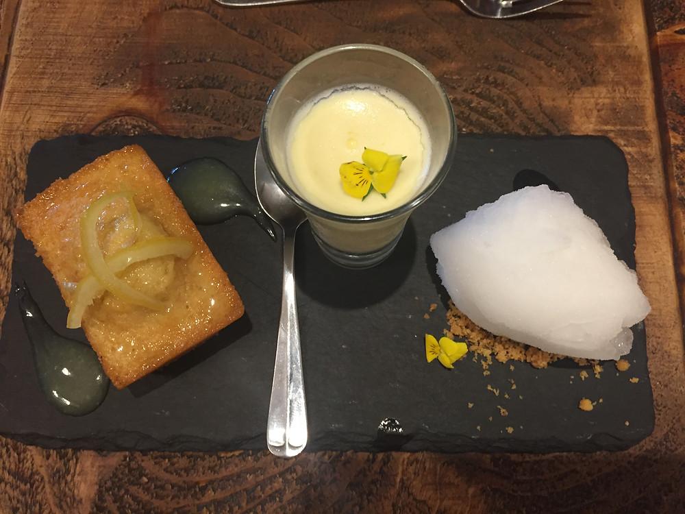 Dessert of Lemon Drizzle cake Lemon Possett and Conker Gin sorbet