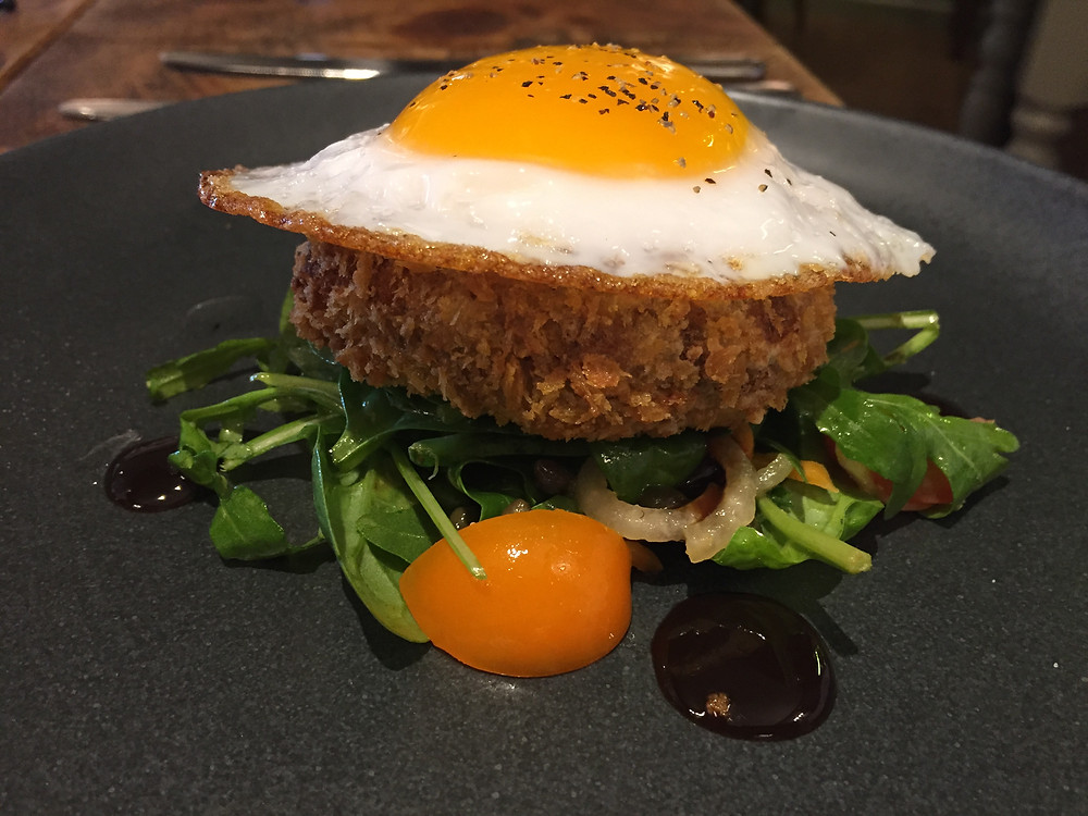 Beautifully presented pulled pork hash topped with a perfect fried egg