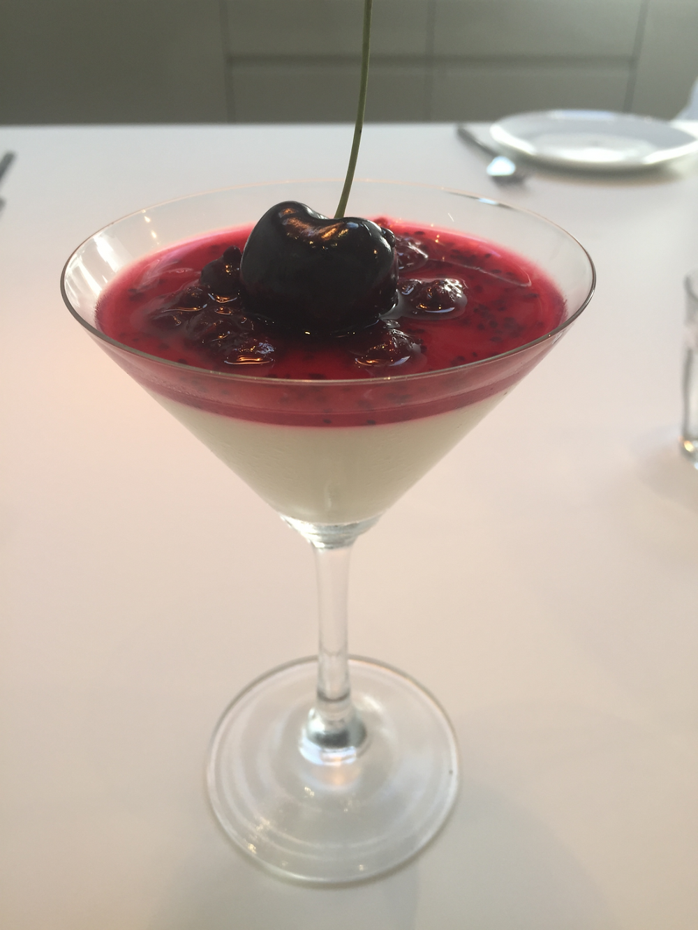 Buttermilk dessert with blackcurrant and cherry topping