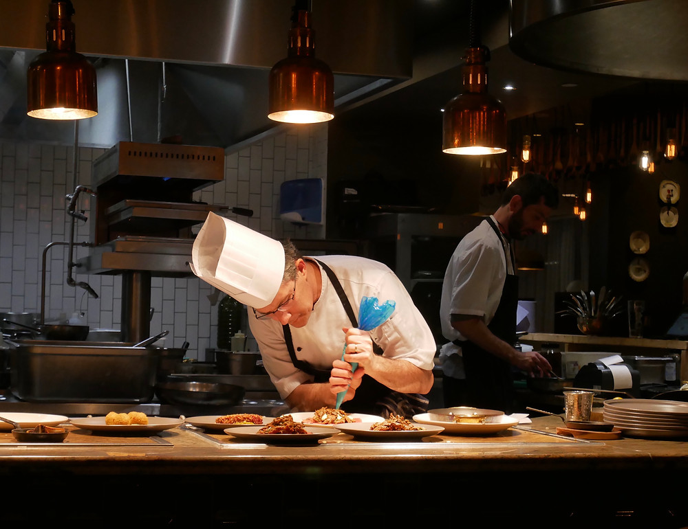 Chefs plating at Schpoons & Forx