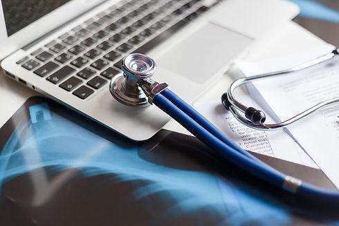 doctors-desktop-with-medical-equipment-c