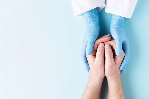 doctors-hands-holding-mans-hands-8UXPKYT
