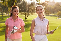two-female-golfers-walking-along-260nw-3