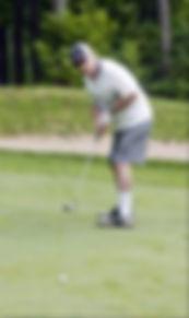 senior golfer putting.jpg