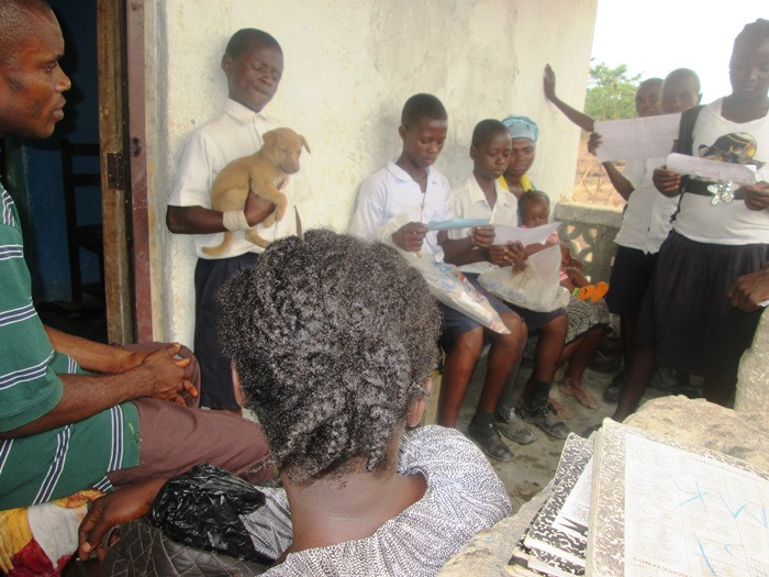 Voinjama students discussing animal care