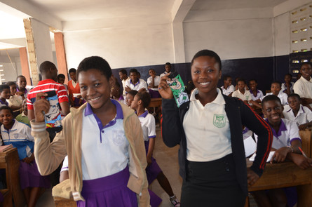 Esther (right) and Zainab(left) the two answered the most difficult question and awarded a pair of sock each.JPG