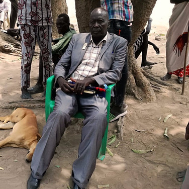 A dog and her owner in Juba