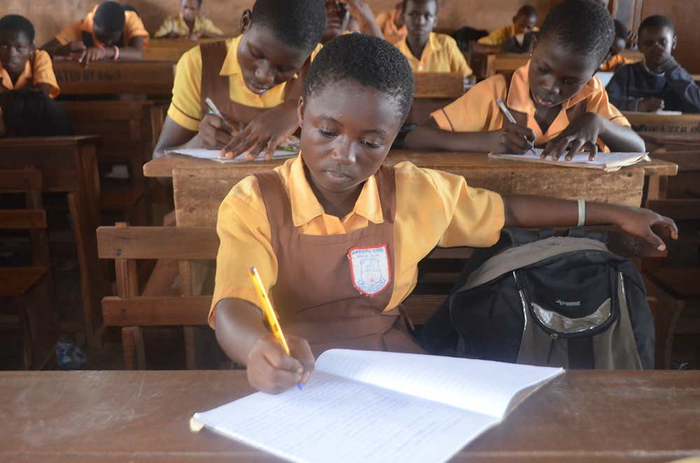 Amrahia Basic School student concentrating on the HE questions
