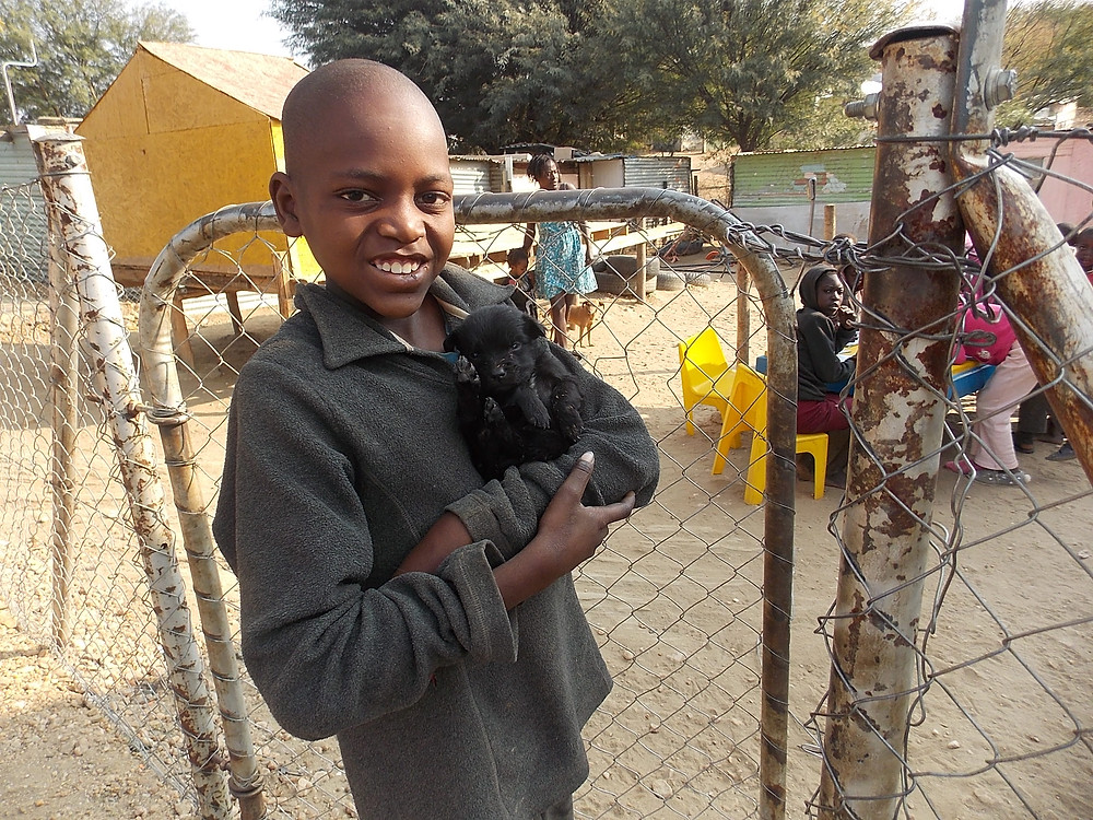 Aug 4-This boy has a new pet; he gets advice from the volunteers about how to care for a puppy