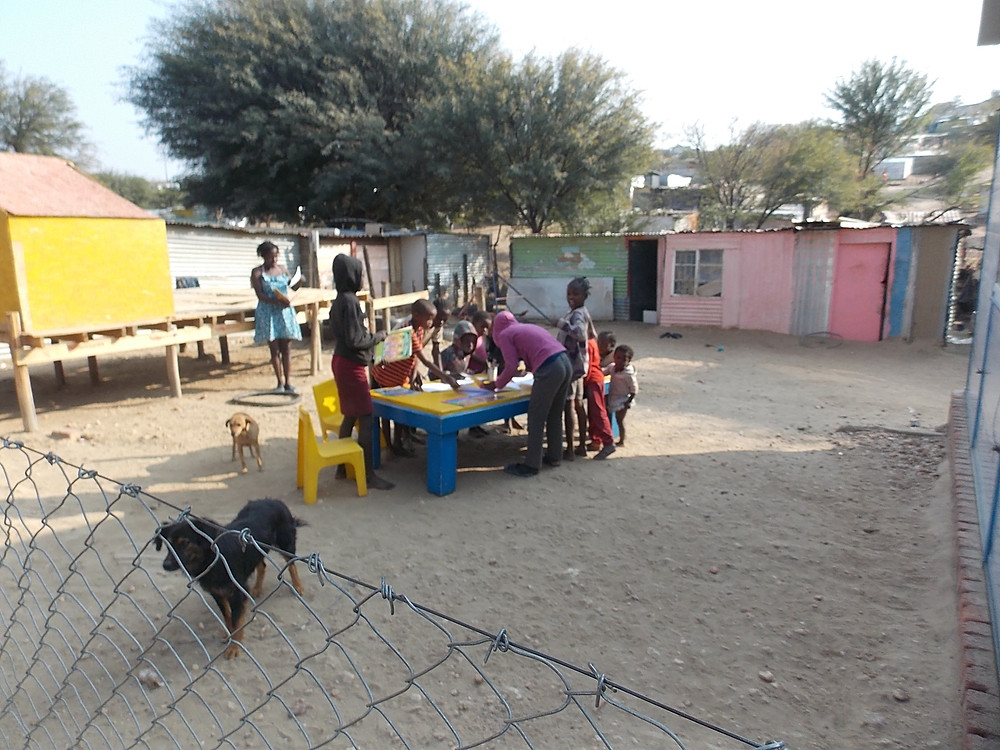 Aug 4 Feeding & Dipping Day: the team sets up on the grounds of a kindergarten