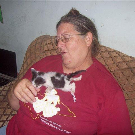 Pilar with a rescued kitty