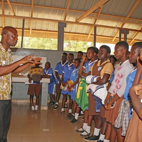 Students listen to speaker.JPG
