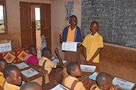 James Tetteh (blue jacket) Secretary, Donkey Kindness Club works with Enoch to lead the lessons.JPG