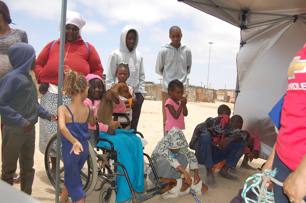 Some of the mobile clinic clients and their families