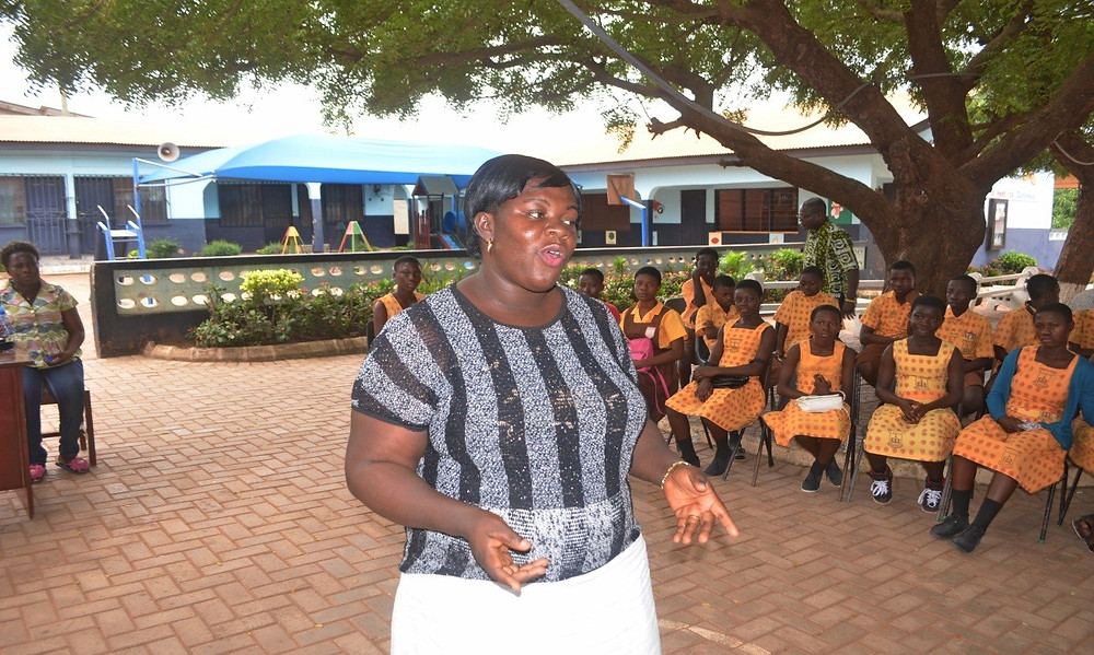 Madam Bernice of Kwabenya, M/A 5 Humane Education teacher, addresses the gathering