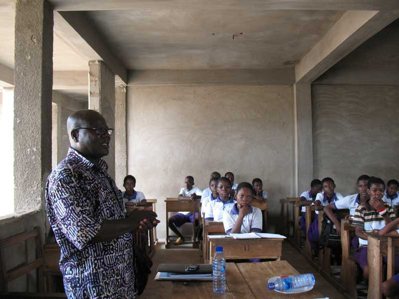 GSPCA's Director, David Nyoagbe, speaks to the Humane Ed class at Trust Academy