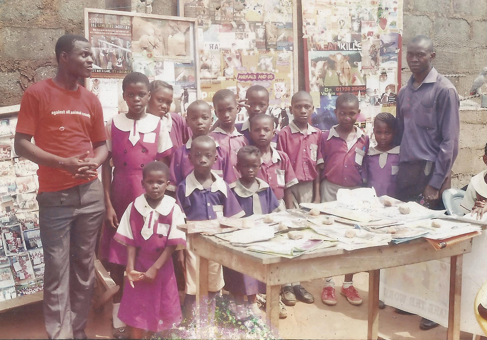 Chiemeka with students and the Humane Ed material he's received from many groups