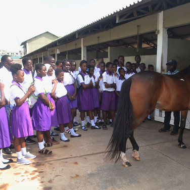 Nov Accra Polo Club students with a larg