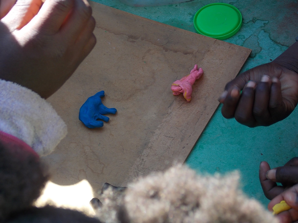 July Katutura visit-kids made animals from clay