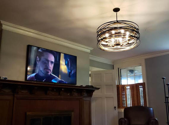 Fully integrated television with high output ceiling speakers and hidden subwoofer.