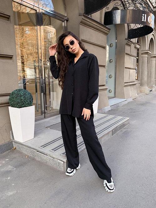 Черный костюм рубашка и широкие брюки фото
