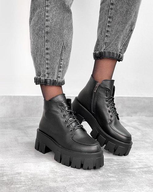 Черные натуральные кожаные ботинки на тракторной платформе фото