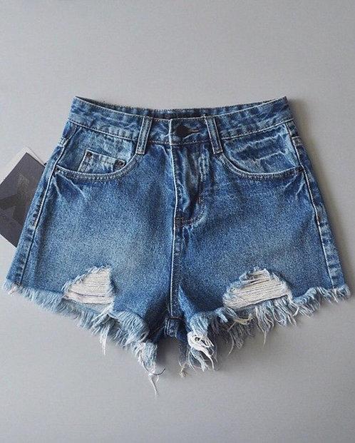 Джинсовые шорты с необработанными краями фото