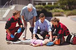 paramedics-examining-injured-girl.jpg