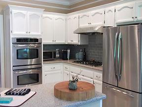 kitchen white cabinets blue tile