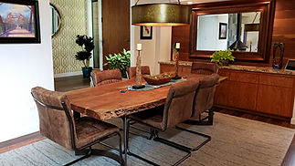 Contemporary dining room with a live-edge table