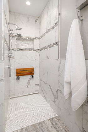 curbless shower grey tile seat